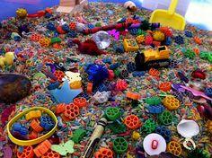 rainbow I Spy sensory tub - this blogger has a bunch of great sensory combinations