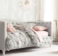 RH TEEN's Selby Tufted Daybed:Beauty sleep. Inspired by refined furnishings of the 19th century, our platform-style daybed's features graceful arches and an elegant rounded footboard with turned feet. Allover tufting completes the timeless design. More