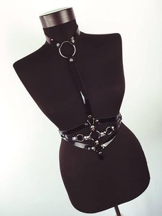 Rock the Hardcore Look in the bedroom or the streets with this eye-catching glossy black Chest Harness with Chains. Made from genuine leather and quality metal hardware, this body harness features a removable chain belt so you can rock two looks in one. Each harness is delicately