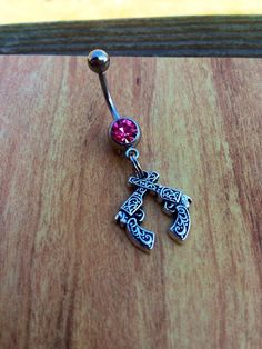 Hey, I found this really awesome Etsy listing at https://www.etsy.com/listing/184519220/crossed-pistol-belly-ring-gun-belly-ring