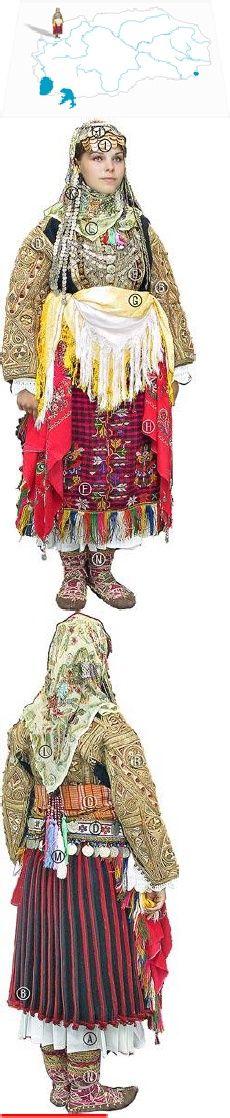 Gorna Reka bride, turn of the 20th c Košula so kindoi (pleated bridal dress), Mintan & Džamadan(slvless undergrmnt); Dolama (embr jkt); Skender pojas (wool sash); Poš (silk sash);Kolan so pari (beltw/coins); Gerdan (jewellery worn at bust); Pešterka (apron); Šamija (scarf); Fes so trepetulka (hat trimmed w/gold coins); Tas (oval metal cap) w/attached Veški (cotton strips covered in coins); Marama (headscarf w/sm beads). In the hair are Kitki (tassels of cotton threads )