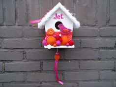 Decorated birdhouse with baby's name and music box by Hippelotshop, €22,50