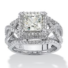 TCW Princess-Cut Cubic Zirconia Platinum over Sterling Silver Halo Bridal Ring Set. Double shanks bypass each other on either side of the princess-cut cubic zirconia creating a truly elegant effect. Princess Cut Engagement Rings, Engagement Ring Cuts, Princess Wedding, Solitaire Engagement, Modern Jewelry, Fine Jewelry, Beach Jewelry, Jewellery, Jewelry Rings