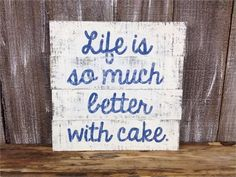 Listing is for 1 Life is so Much Better With Cake sign.  Measurements: 12 inches tall Approximately 12 inches wide 1 inch thick with backing  This simple cursive sign features the phrase Life is so much better with cake, on a black and white background. The entire piece is distressed to show the layers of paint as well as the natural wood underneath.  Includes a sawtooth on the back as well as a built in stand if you want to display it on a counter/shelf/etc.