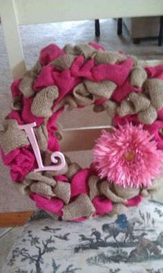 Burlap wreath! Would be super cute for a baby girl's room!