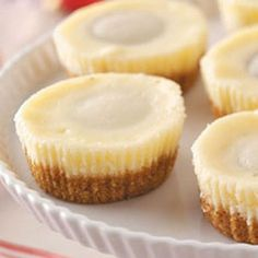 """Miniature Peanut Butter Cheesecakes Recipe- Recipes """"These yummy treats, with a peanut butter cup inside, were handed down to me from my mother,"""" notes Mary Ann Dell of Phoenixville, Pennsylvania. They're perfect for holidays or any special occasion. Peanut Butter Cheesecake, Peanut Butter Cups, Cheesecake Recipes, Dessert Recipes, Cheesecake Cups, Just Desserts, Delicious Desserts, Yummy Food, Dessert Healthy"""