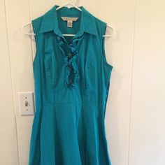 Teal A.B. studio dress with ruffle detail flirty ruffle front and bottom makes this a fun dress for any occasion AB Studio Dresses Midi