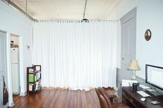 curtains as room divider, maybe use a tension-rod to prevent holes in the walls?! :)