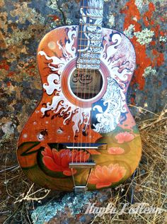 This guitar is done entirely in Sharpie. It's for sale on my Etsy website. Let me know what you think!