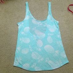Like new VS PINK pineapple tank top Super cute baby blue green with white pineapples and scoop back like new condition tag cut out PINK Victoria's Secret Tops Tank Tops