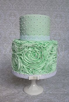 Mint rose ruffle cake - All fondant mint rose ruffle bridal shower cake. The ruffling took 8 hours, due to a couple of false starts. I used the lovely Sharon Wee ruffle tutorial. This is my second cake with this technique, and the first try on a double barrel cake.