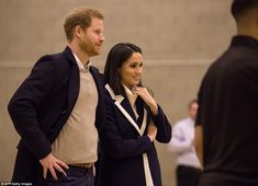 The couple were watching 14 city apprentices go through what is the group's final collecti...