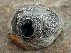 Oxidised silver pated brass stamping bracelet with montana blue glass stone  looking-glass-jewellery.com  & facebook!