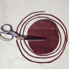 cutting leather into a long strand for jewelry