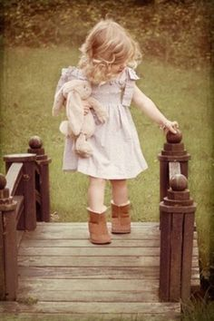 What wonders await this little girl, with her bunny clutched tight, armed with curiosity and awe