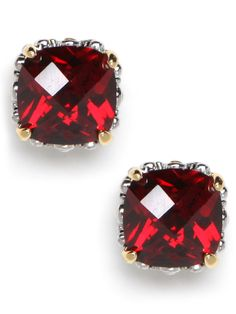 Oversized glass stud earrings in a feminine hue are the prettiest understated accent. Glass cushion cut stones in a rich garnet hue are set in a gold-tone base.