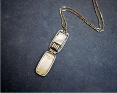 """smaller USB Locket with the same function and feel as its larger predecessor. The Mini USB Locket comes with a flash drive for storing and sharing all of your photographs (and files).  Comes on a 24"""" brass chain, 2GB flash drive included.  24k gold-plated  $170"""