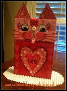 Kitten box: decoupage cereal box with card slot and back door for goodie access.