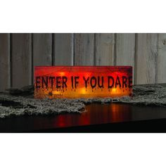 The Enter If You Dare sign lights up. It is made of canvas over a wooden frame. It has an on and off switch on the side with a timer that shuts it down in six hours. This Halloween addition is a great                                                                                                                                                     More