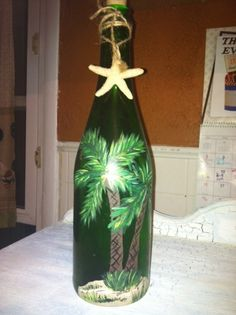 wine bottle art. I painted a palm tree beach scene and added a star fish with string around the top. You can also out a small string of lear christmas tree lights inside and plug in for ambience