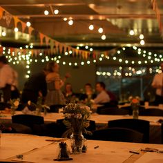 We hired lights and tables, made the bunting, and covered the tables with bargain lace curtains, butcher's paper, crayons and jam jars full of poppies and ranunculus Butcher Paper, Lace Curtains, Ranunculus, Crayons, Bunting, Jars, Poppies, Tables, Lights