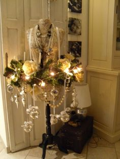 nifty use for a garland or wreath with a dress form - especially for Christmas with ornaments!