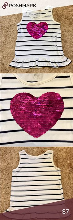 Girl's Heart Top Selling a gently used Girl's Heart Top.  This cute top is made from 100% cotton and & great for those hot summer days!  Decorated with black stripes all around with a ruffled bottom. Off white in color. Approximately 18 inches in length and Medium (7/8) in size. Shirts & Tops Tank Tops
