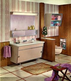 Love the shape of this bathroom vanity cabinet. (note: clearly Orla Kiely's most infamous pattern design isn't so original--check out that wallpaper!)