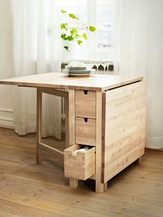 Natural wood minimalist space saver dining table plus storage and extra counter top space