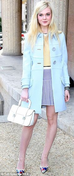 In style: As one of the faces of Miu Miu's latest campaign, Elle was at the show along with Lupita Nyong'o, Bella Heathcote and Elizabeth Ol...