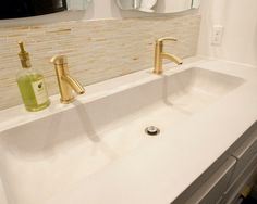 2 mirrors, 2 faucets, over trough sink. Use left over back splash from kitchen