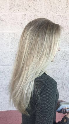 Icy blonde balayage with highlights
