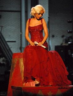 Love the dress -i want this in white for my wedding, and my bridemaids to be in that shade of red