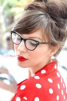 Red lips, cat eye glasses and a messy bun with a lovely fringe