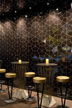 This large scale mosaic shines under track lighting and is a perfect back drop for these gilded bar sets. A geometric artwork can create a similar atmosphere!