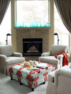 Neutral colored sofa and chairs (white or gray) with a funky red and aqua ottoman in the middle. #bebetsy #contest