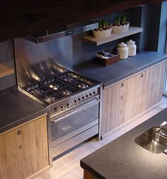 Love the dark counters and backsplash with the lighter wood cabinets