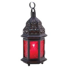Cast a flickering glow over your living room mantel or foyer console table with this lovely candle lantern, featuring an openwork design and ruby glass panel...