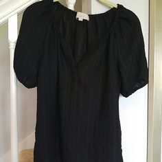 Loft shirt size medium Black with tonal semi sheer striping.  Elastic at neck and sleeved.  Hidden buttons down top half of blouse.  Light weight and flowy. LOFT Tops
