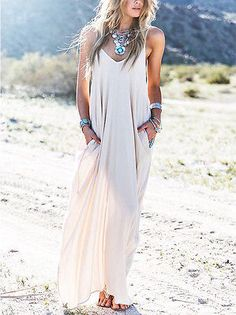 Tan Maxi Dress A loose fitting v-neck spaghetti strap chiffon maxi dress with pockets. Pair it with messy hair and some jade jewelry.Boho Nautical Maxi Deep cut, belted, and beautiful! Nothing says summer...