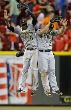 June 18, 2013 - Raise it!  Pirates outfielders Starling Marte #6, Travis Snider #23 and Andrew McCutchen #22 celebrate after defeating the Cincinnati Reds 4-0  in Cincinnati.