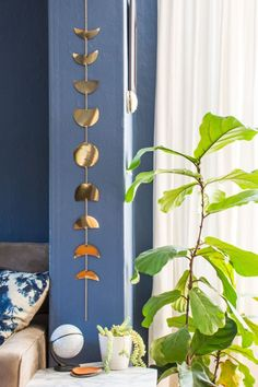 DIY moon phases wall garland: Make this easy moon phases wall hanging with gold foil paper and chain.
