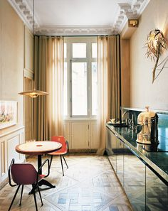 Narrow galley kitchen in Parisian-inspired space