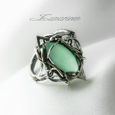 green and silver handmade ring