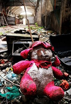 A teddy bear in an abandoned factory in Italy (by PratoBestia)