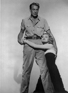 Full publicity shot of and Patricia Neal as Dominique on knees embracing Gary Cooper as Howard Roark.