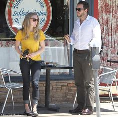 Amanda Seyfried in cute yellow t-shirt, turned up jeans & ballet flats