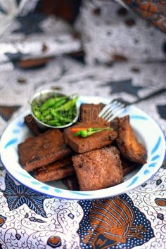 Tahu Bacem -- by indonesiaeats, who made it for Viet banh mi. There's a recipe for the Java twice cooked, spiced up tofu in Asian Tofu. Fab stuff.