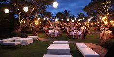 White lounge furniture, lanterns and dining tables  Four Seasons Resort Hualalai