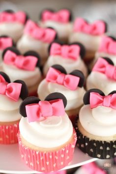 These Minnie Mouse cupcakes are adorable topped with fondant bows and Minnie's ears, and placed in pink polka dot wrappers! See more party ideas and share yours at CatchMyParty.com #catchmyparty #partyideas #minniemouseparty #minniemouse #girlbirthdayparty #girl1stbirthdayparty #minniemousebabyshower #minniemousecupcakes